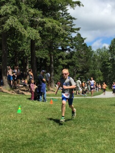 Josh sprinting to an age group win